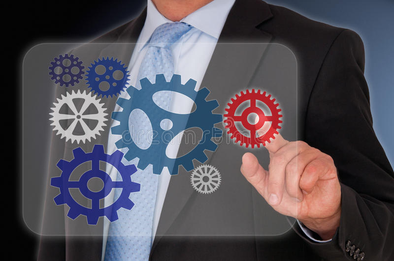 Download Businessman touching cogs stock image. Image of adult - 31763653