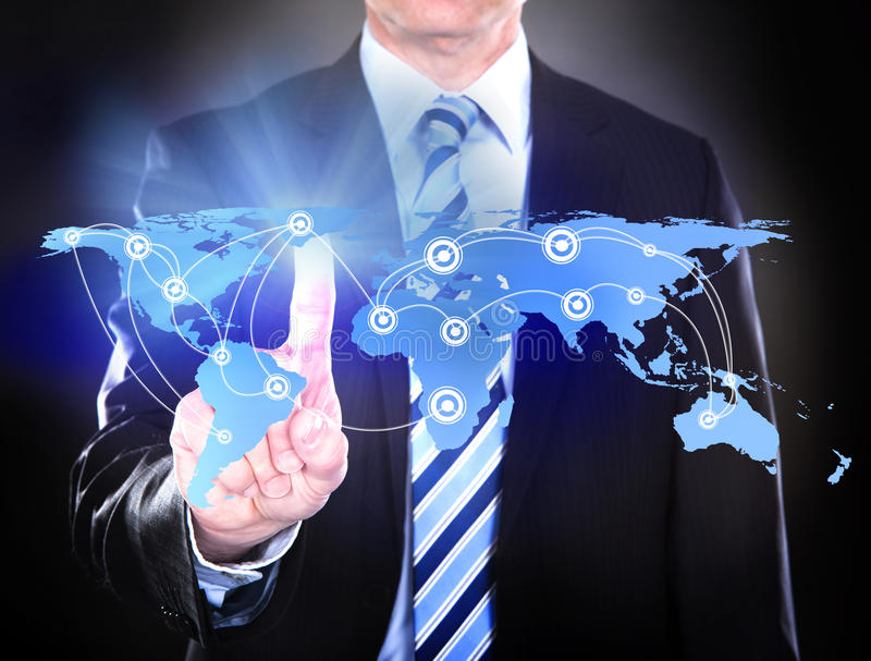 Businessman touching connected world map. Midsection of businessman touching connected world map representing global business over black background. Source of stock photos