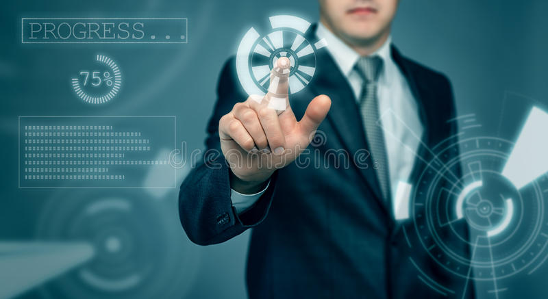 Businessman touching the digital touch screen by his finger stock photo