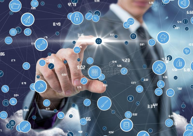 Businessman touching digitally generated connecting icons. Mid section of businessman touching digitally generated connecting icons royalty free stock photo