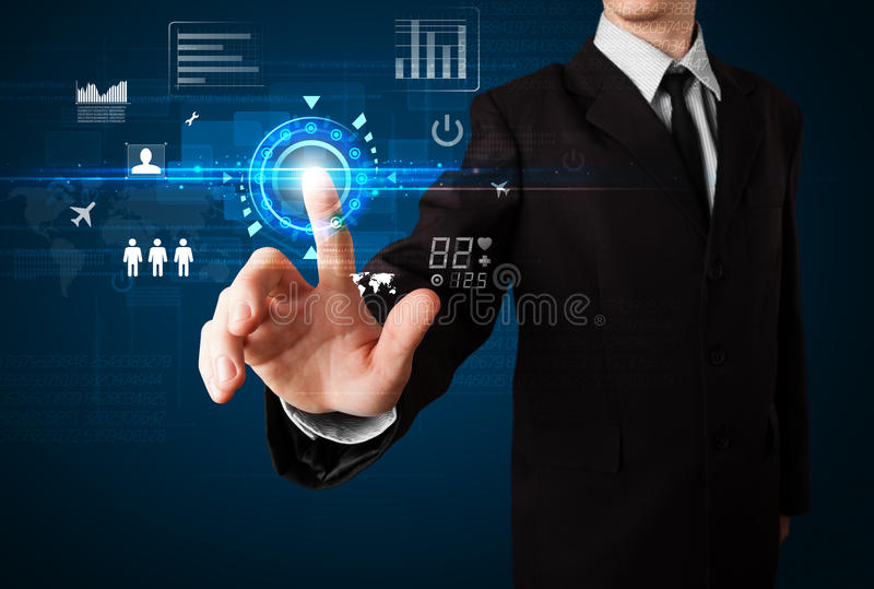 Businessman touching future web technology. Buttons and icons royalty free stock photo