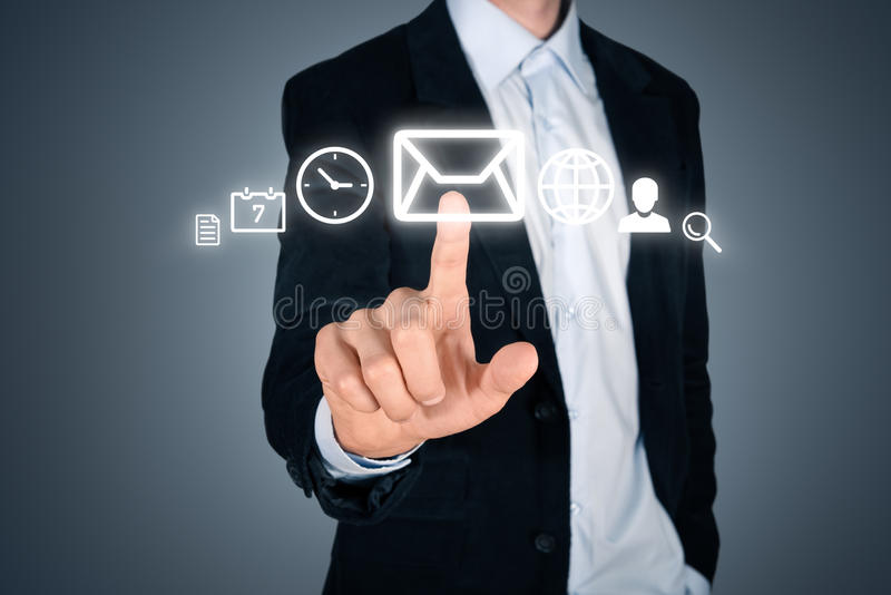 Businessman touching futuristic interface with icons stock images