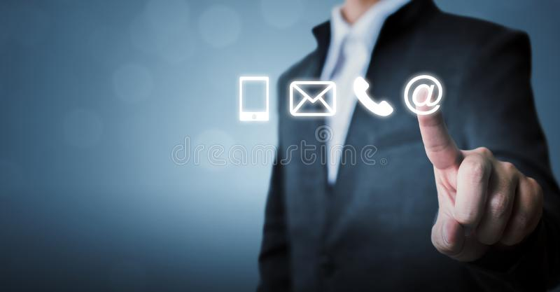 Businessman touching icon mobile phone, mail, telephone and address. Customer service call center contact us concept royalty free stock photography