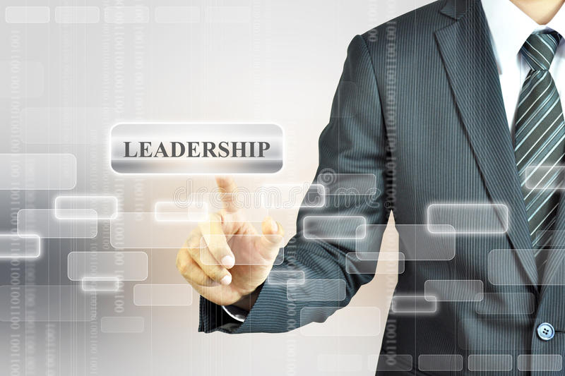 Businessman touching LEADERSHIP sign stock photos
