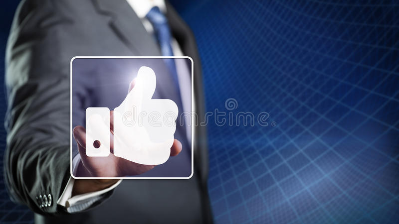 Businessman In Office With Computer And Fan Stock Photo