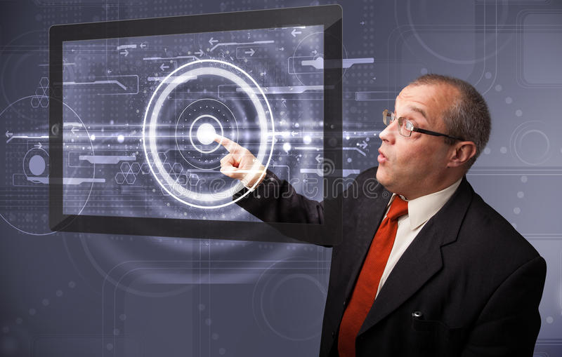 Businessman touching modern technology tablet. Businessman standing and touching modern technology tablet stock images