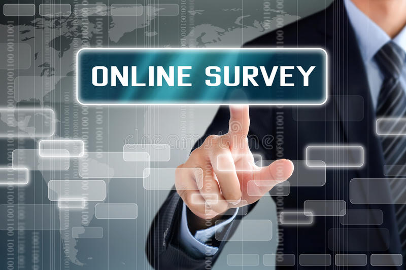 Businessman touching ONLINE SURVEY button on virtual screen stock images