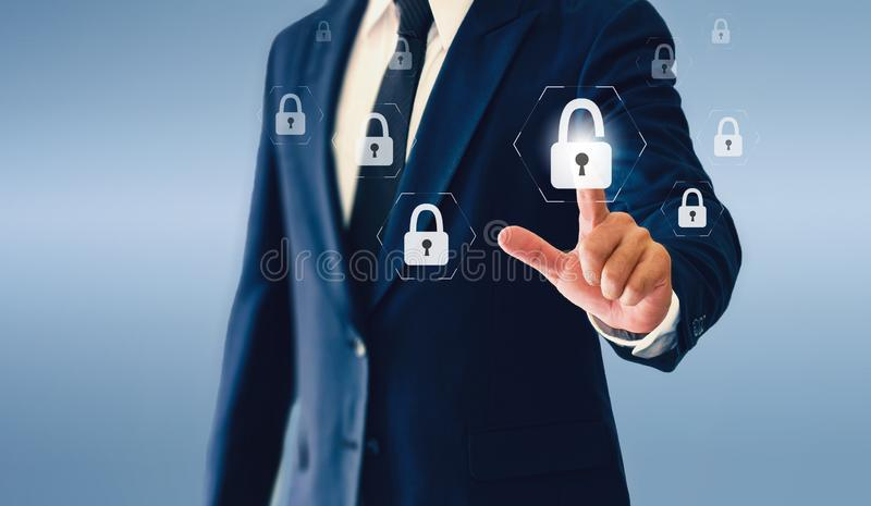 Businessman touching padlock virtual button. Concept of successful business or security. stock photos