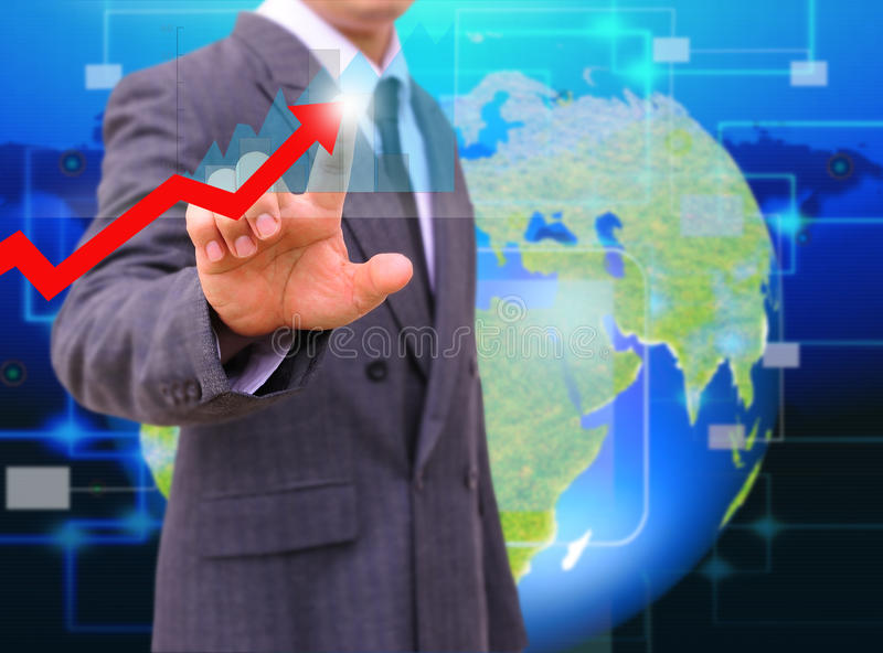 Businessman touching a rising arrow . business growth Concept royalty free stock images