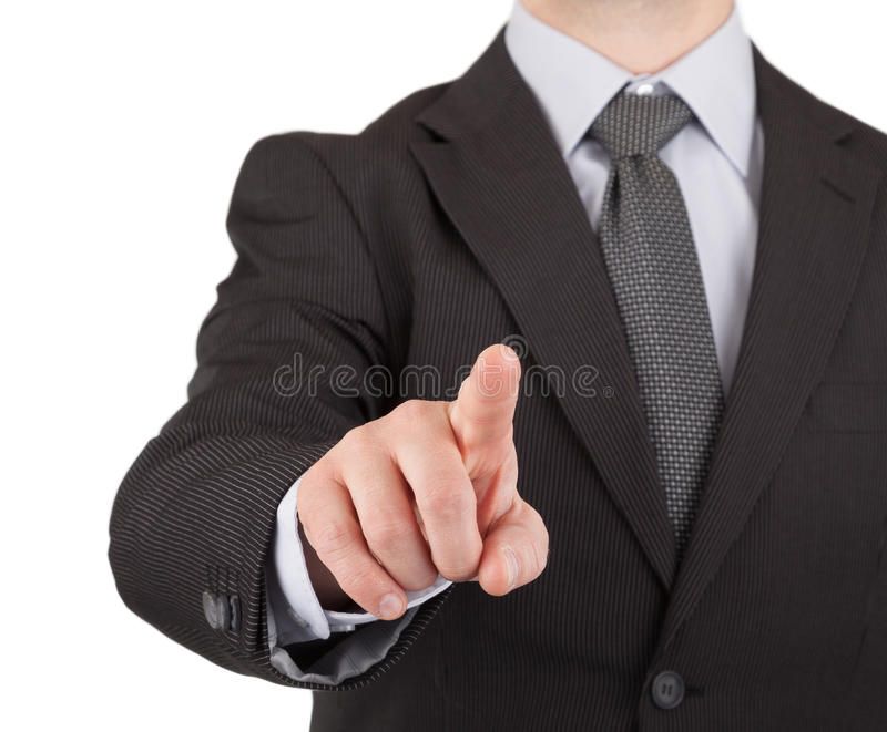 Businessman touching virtual screen or button stock image