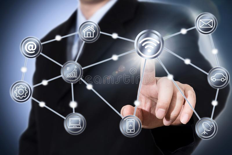 Businessman touching a wifi icon stock photography