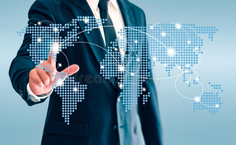 Businessman touching world map virtual button and connect communication stock images