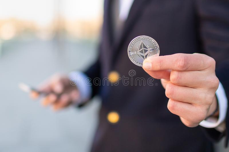 Businessman trader holding Ethereum cryptocurrency. royalty free stock photography