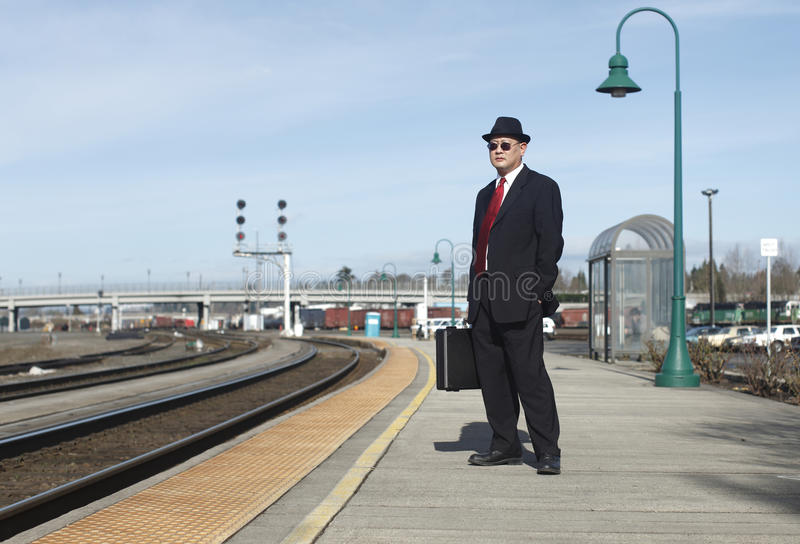 Businessman at a train station