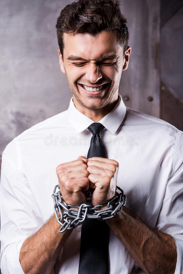 Businessman trapped in chains. stock image