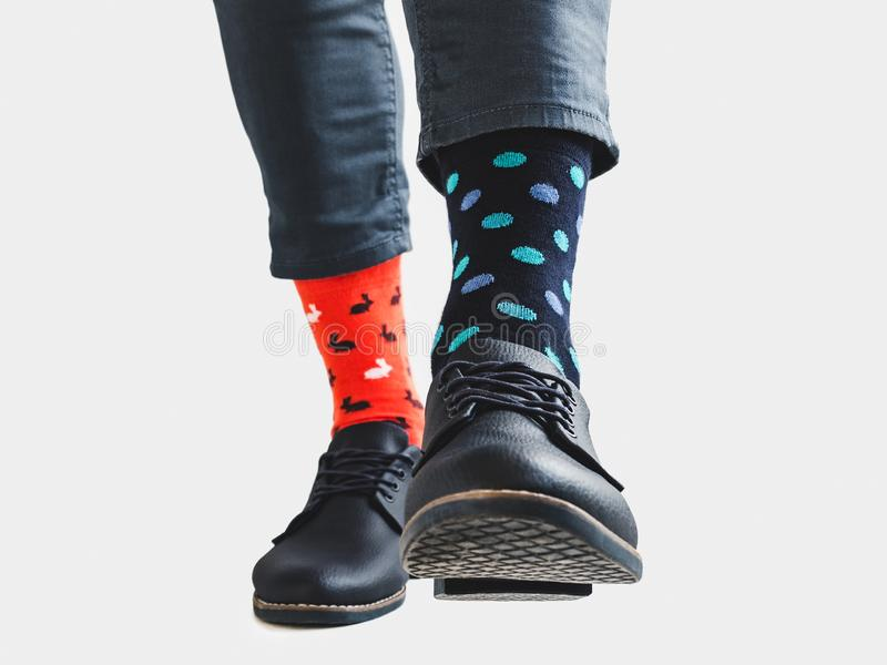 Businessman, trendy shoes and bright, colored socks. Businessman, trendy shoes, blue trousers and bright, multicolored socks with a pattern of polka dots on a royalty free stock photo
