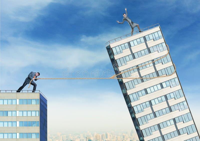 Businessman tries to push down businesswoman stock photos