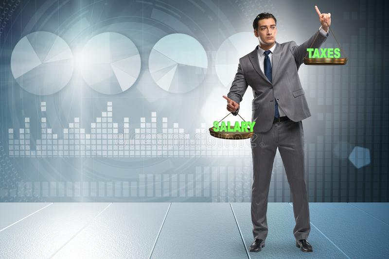 Businessman trying to find balance between taxes and salary. Businessman trying to find balance in taxes and salary stock photos