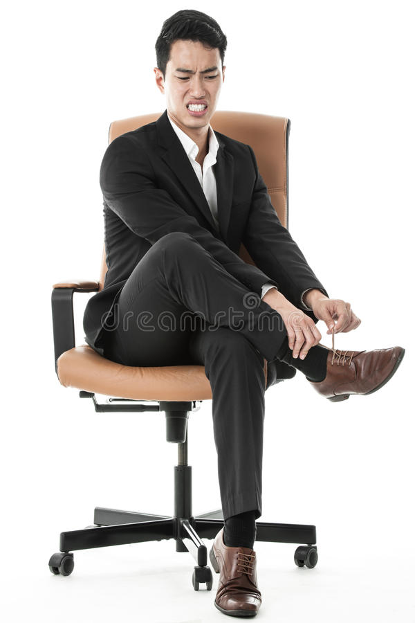 Businessman Tying His Shoe Lace Stock Photos