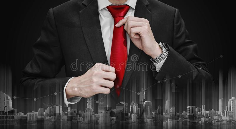 Businessman tying red necktie and raising graph diagram with download businessman tying red necktie and raising graph diagram with building technology business growth and ccuart Gallery