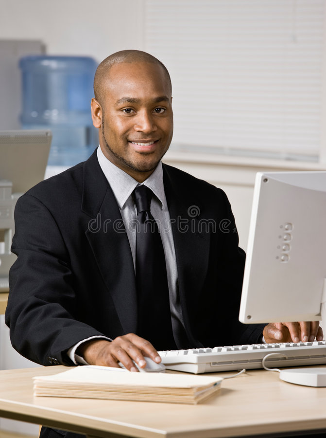 Download Businessman Typing On Computer At Desk Stock Image - Image of african, person: 6602009