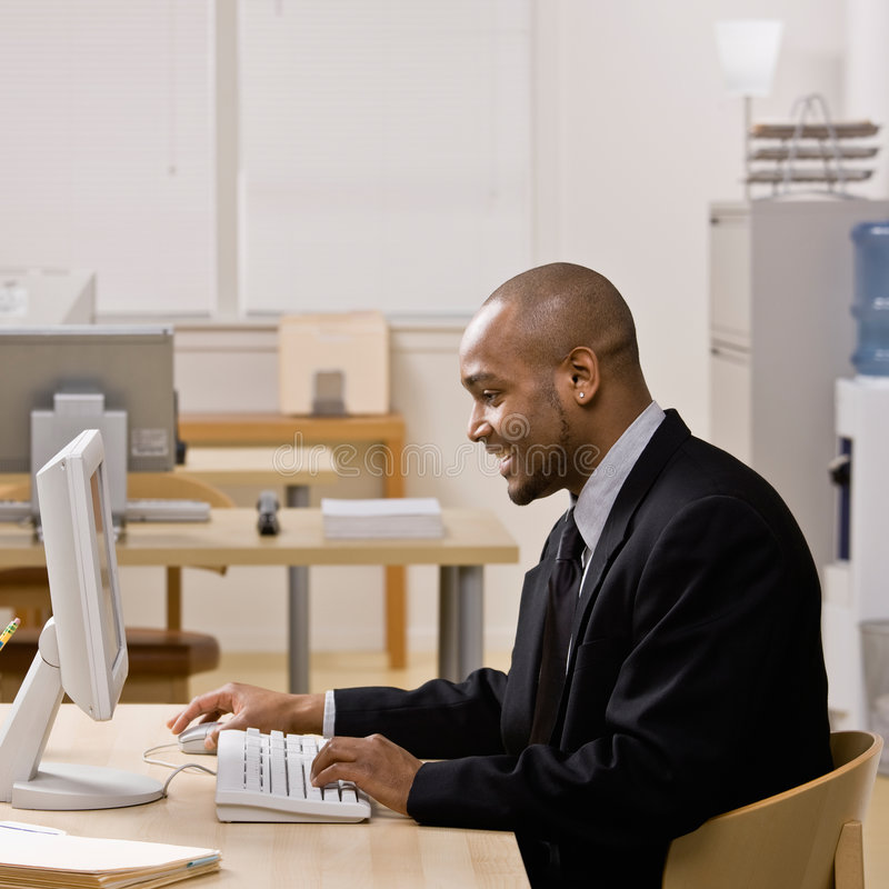 Download Businessman Typing On Computer At Desk Stock Image - Image: 6602131