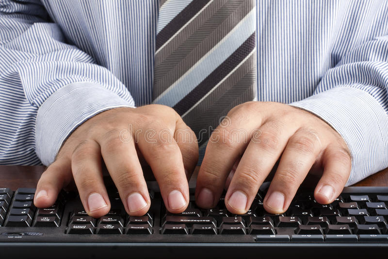 Businessman Typing Keyboard Desk Hands stock photo