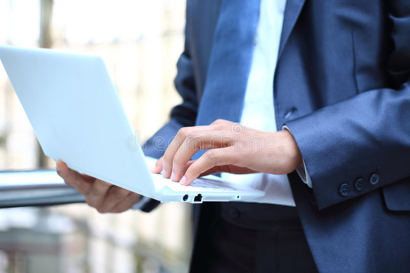 Download Businessman Typing On Laptop Computer Stock Image - Image: 30650395