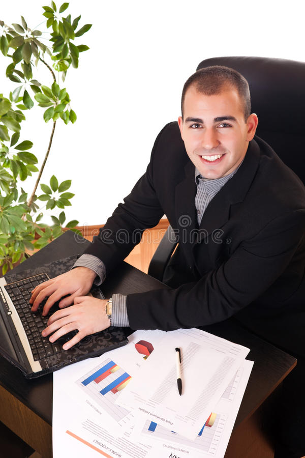 Businessman typing on laptop in office royalty free stock photo