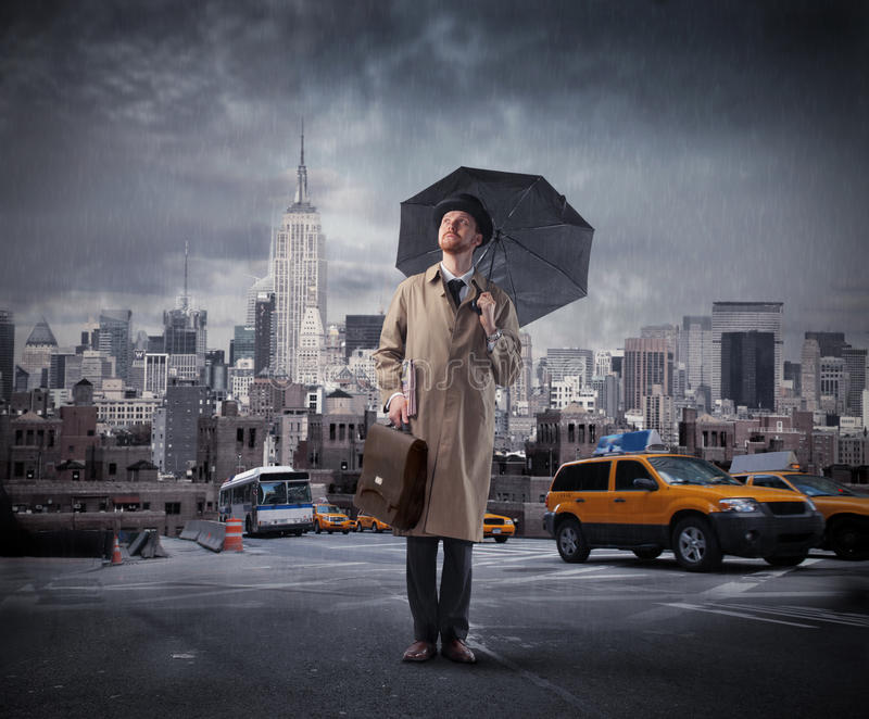 Businessman with umbrella royalty free stock photography