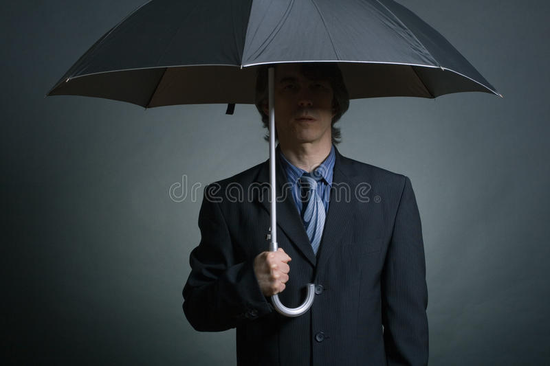 Download Businessman with Umbrella stock photo. Image of advocacy - 24416488
