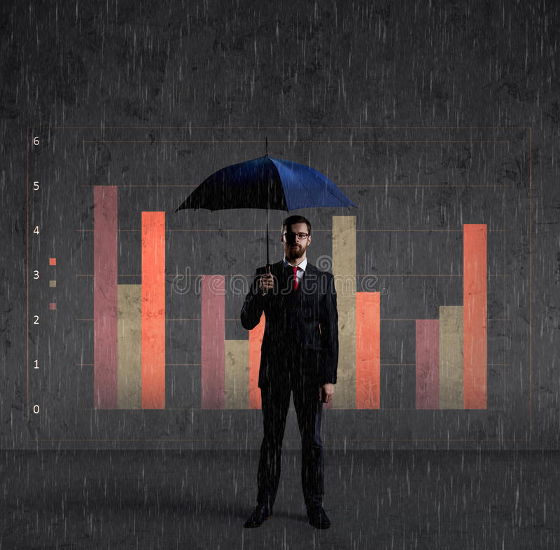 Businessman with umbrella standing over column diagram background. Business, default, change, crisis concept. stock image