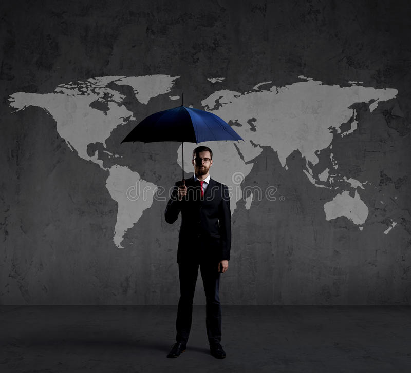 Businessman with umbrella standing over world map background. Business, risk, insurance, concept. stock images