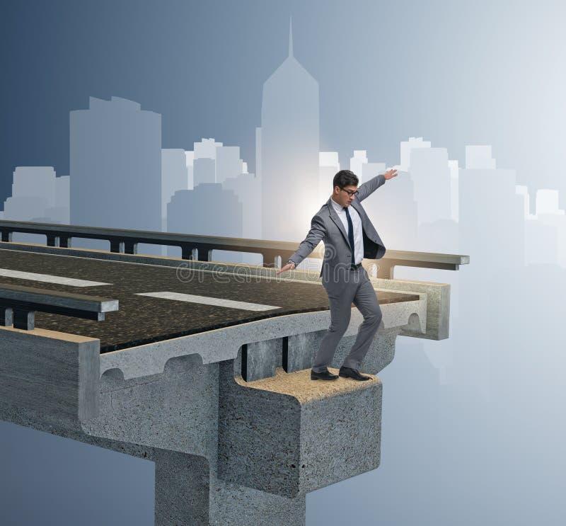 Businessman in uncertainty concept with broken bridge royalty free stock photos