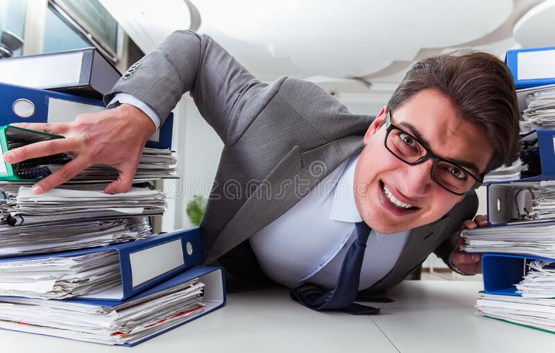 Businessman under stress due to excessive work royalty free stock photos