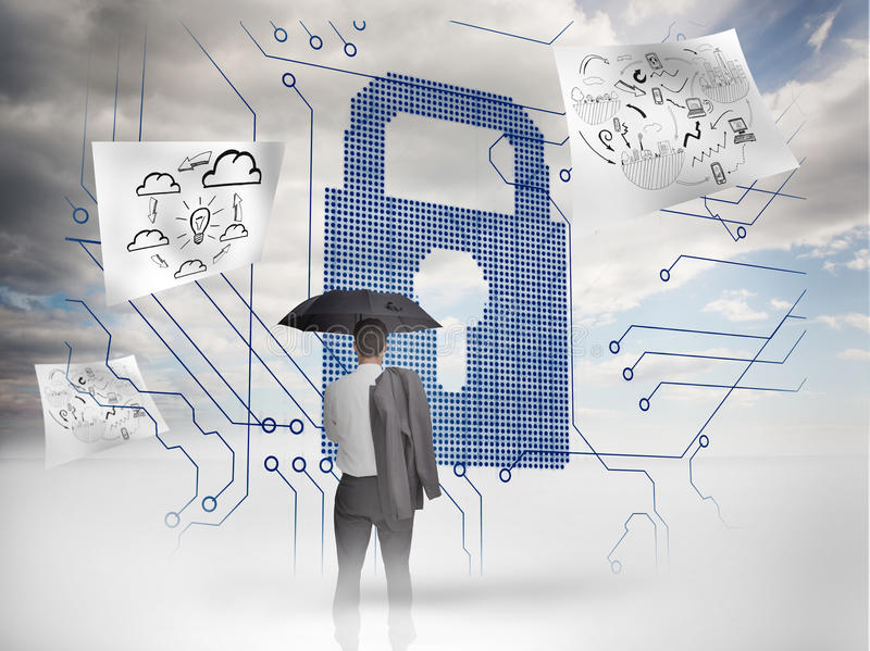 Businessman under an umbrella looking at a giant padlock. With drawings floating around royalty free stock image