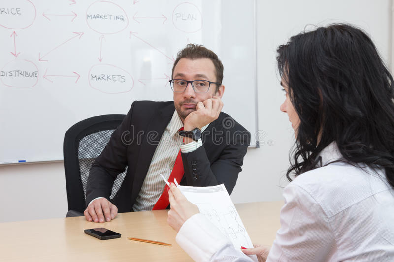 Businessman unhappy with the ideas of his female coworker stock photos