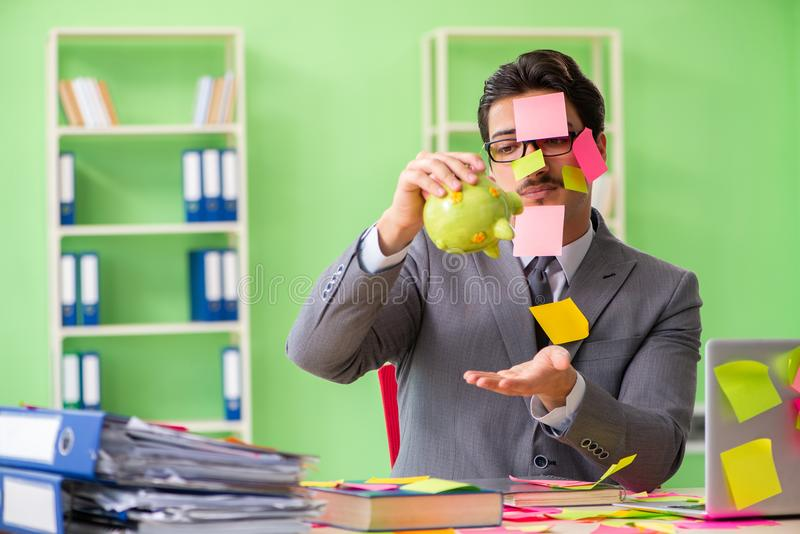 Businessman unhappy with many conflicting priorities sitting in stock image