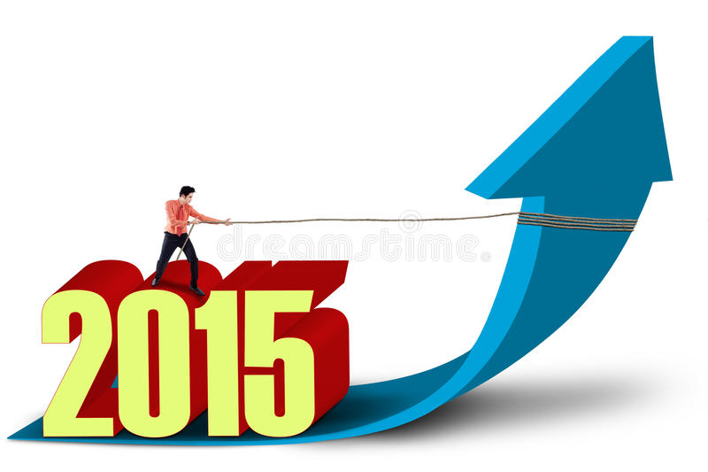 Businessman with upward arrow and number 2015 royalty free illustration