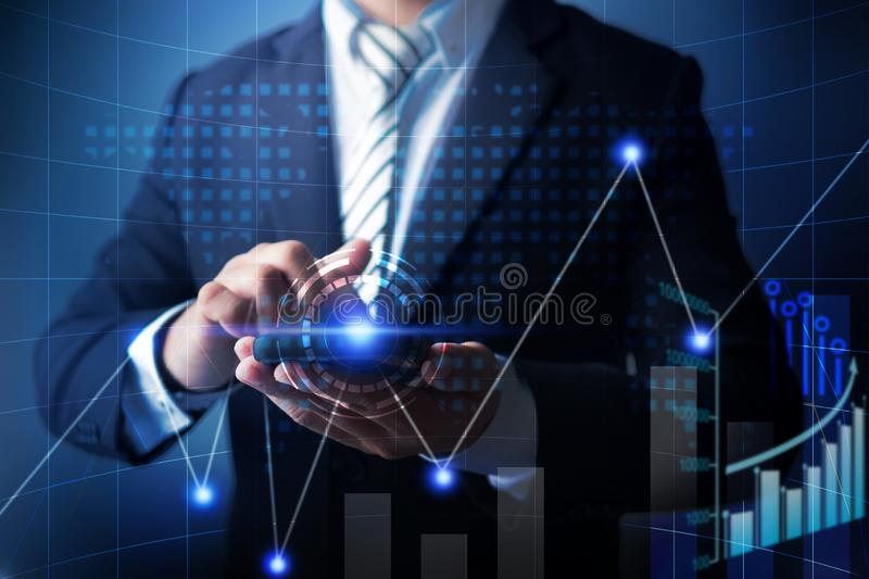 Businessman use cell phone to analyzing data of finance business with economic digital graph chart, technology planning banking to. Investment and profit royalty free stock photos