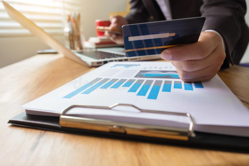 Businessman use credit card to shopping online. Businessman use credit card to shopping online in internet website shop with computer laptop and smart phone on stock photo