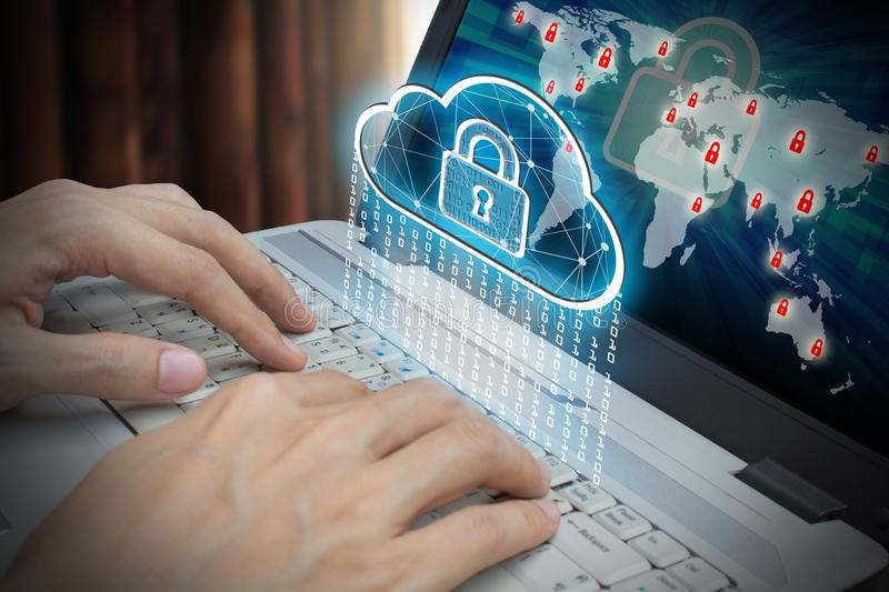 Businessman use Laptop with interface of padlock and cloud computing stock photography