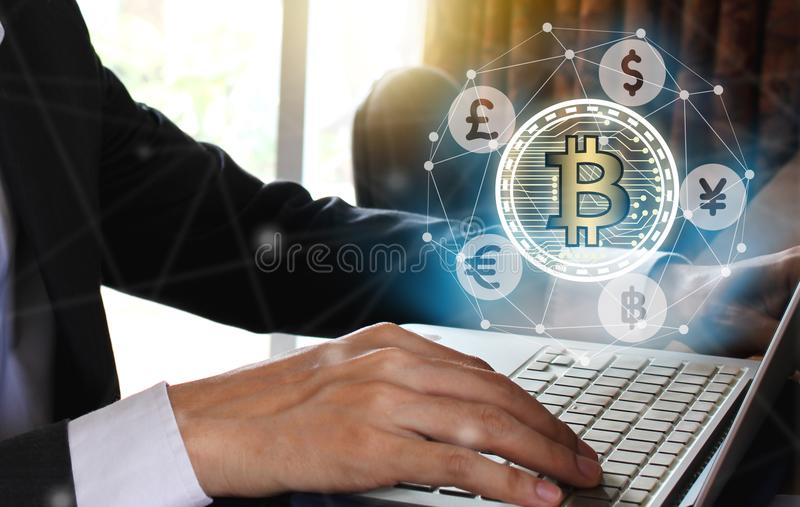 Businessman use Laptop with virtual screen bitcoin and fintech,. Virtual currency blockchain technology concept, Internet Concept of global business stock photo