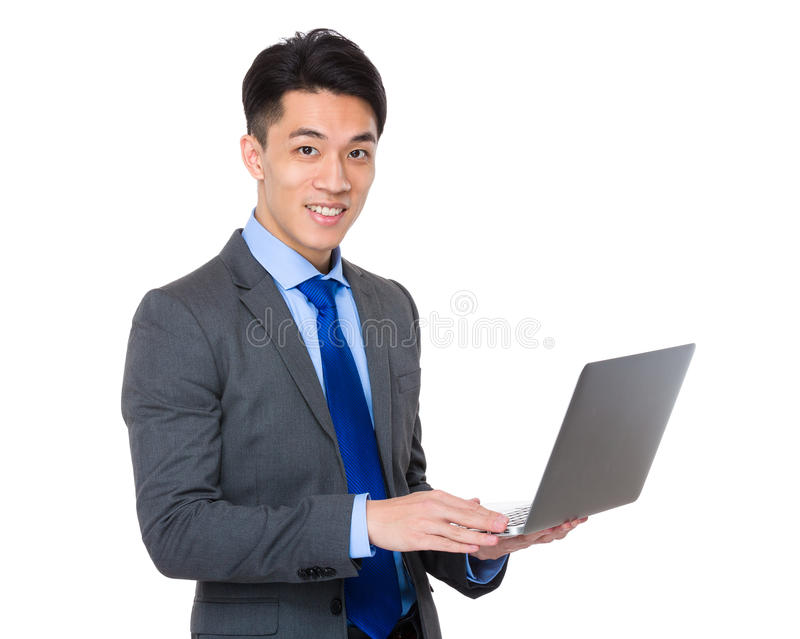 Businessman use of portable computer. Isolated on white background royalty free stock photo