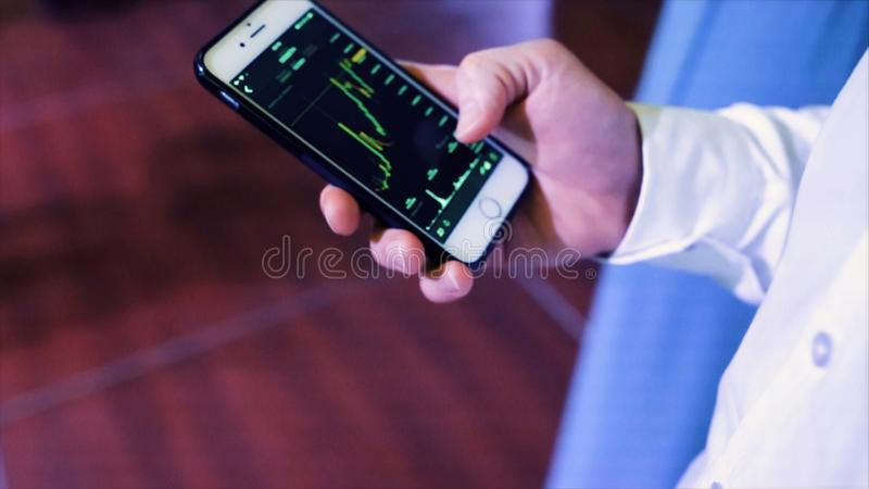 Businessman use smartphone check income from stock exchange worldwide. Stock. Online format holographic on phone have stock photos