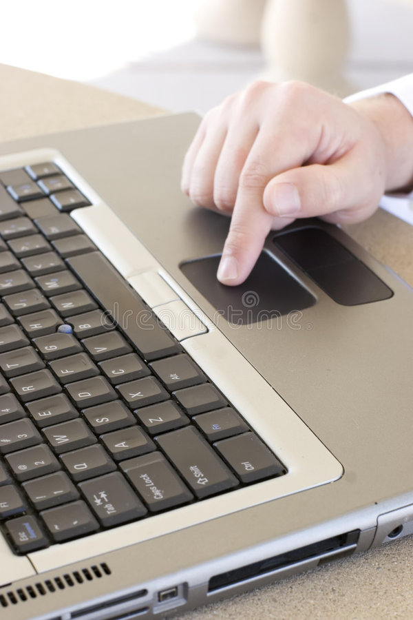 Businessman uses laptop royalty free stock photography
