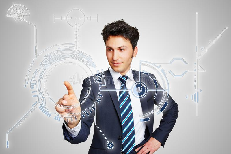 Businessman uses symbolic digital interface. Concept image for new working methods and processes with businessman using symbolic digital interface royalty free stock images
