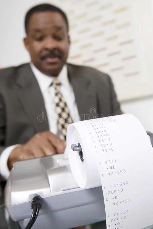 Download Businessman Using An Adding Machine Stock Photo - Image: 29660980