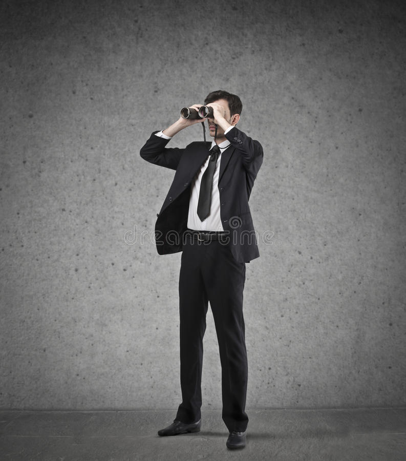 Businessman using a binoculars stock image