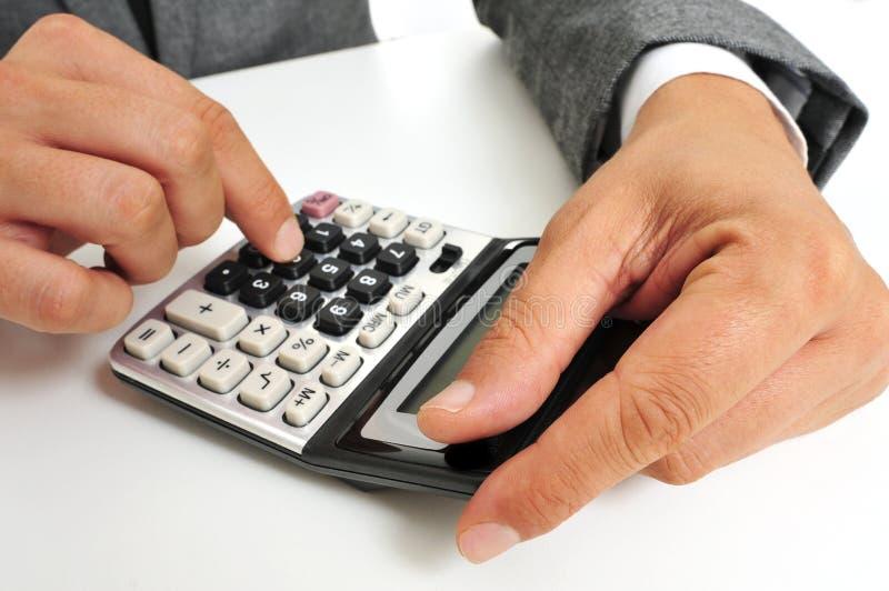 Businessman Using A Calculator Stock Photography